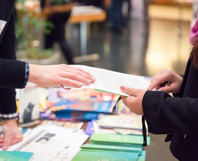 man and women sharing print marketing materials